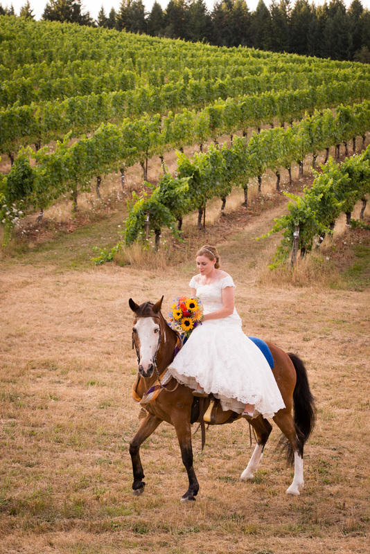 Bride riding a horse on her wedding day at Sarver Winery, Oregon
